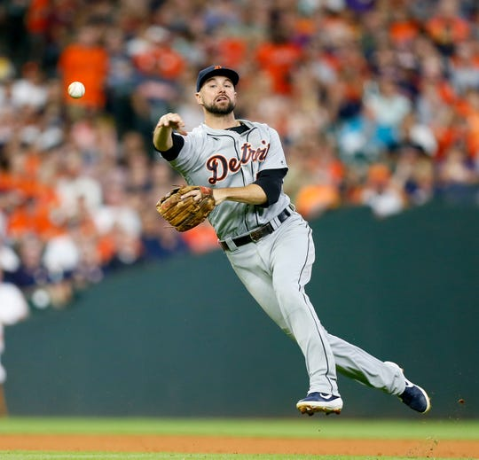 Detroit Tigers' Jordy Mercer throws to first base in the fourth inning but was unable to retire the Houston Astros hitter Monday, Aug. 19, 2019, in Houston.