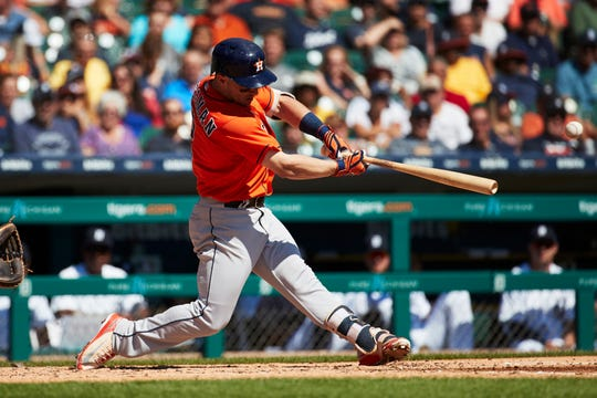 Alex Bregman hits an RBI single against the Tigers at Comerica Park on Sept. 12, 2018.