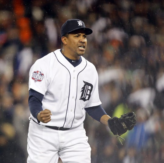 Detroit Tigers pitcher Octavio Dotel reacts to getting the final out in the eighth inning in Game 4 of the 2012 World Series between the Detroit Tigers and the San Francisco Giants at Comerica Park in Detroit, Sunday, Oct. 28, 2012.