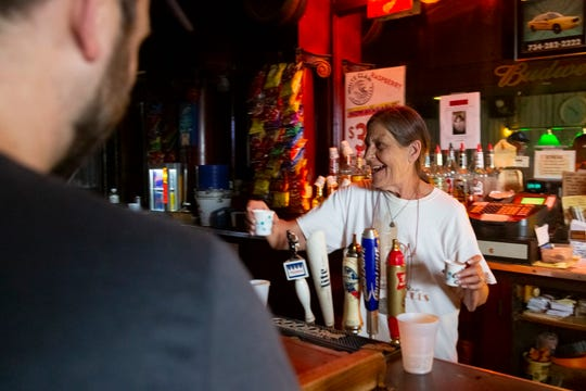 Bartender Valerie Trusewicz-McGraw serves patrons at the Gold Star, Wyandotte's oldest bar. Her grandparents founded the Gold Star in 1923 as a pool hall and blind pig.