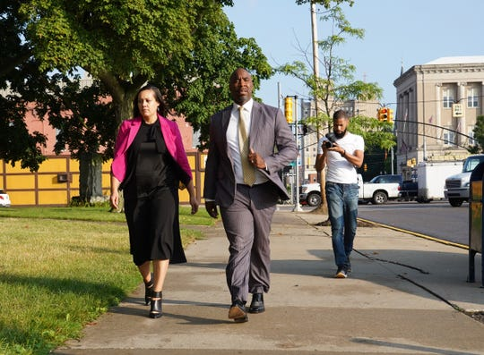 Former Michigan State basketball star Mateen Cleaves walks along Saginaw St. in downtown Flint to Genesee County Circuit Court on Tuesday, August 20, 2019 before closing arguments for his trial on sexual assault charges.Cleaves is charged with numerous counts related to thealleged incident that prosecutors say took place after he met the woman at a charity golf outing in September.