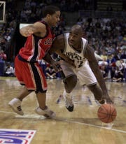 Former MSU guard Mateen Cleaves drives against University of Mississippi Jason Harrison in the second half of MSU's 74-66 victory in their NCAA Tournament Second Round Game at the Bradley center in Milwaukee, Wisconsin on Sunday, Mar 14. 1999.