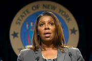 "In this June 11, 2019, file photo, New York Attorney General Letitia James speaks during a news conference, in New York.  New York state, New York City, Connecticut and Vermont have filed a new legal challenge to new Trump administration rules blocking green cards for many immigrants who use public assistance including Medicaid, food stamps and housing vouchers.  James, a Democrat, says the change is a ""clear violation"" of American values and 100 years of case law."