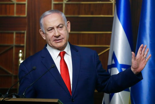 Israeli Prime Minister Benjamin Netanyahu delivers his speech during meeting with businessmen in Kyiv, Ukraine, Tuesday, Aug. 20, 2019.  Israeli opposition leader Benny Gantz's party signed an agreement with a potential kingmaker that could hurt Netanyahu's chances of re-election.