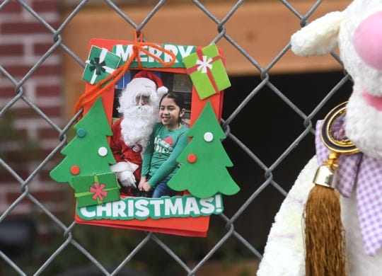 At the home of Claudia Stapleton, aunt of Emma Hernandez, a photograph of Emma Hernandez is attached on a fence in a memorial in Detroit on Tuesday, August 20, 2019. Max Ortiz, The Detroit News