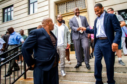 Mateen Cleaves shows a joyous smile as friends and family congratulate him on a not guilty verdict on the steps outside of the Genesee County Circuit Court on Tuesday.