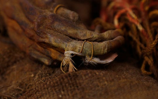 This Aug. 15, 2019 photo shows a 500-year-old mummy of an Incan girl clinging to bird feathers, inside a vault at the National Museum of Archaeology in La Paz, Bolivia. The girl is believed to have been around 8 years of age when she died.