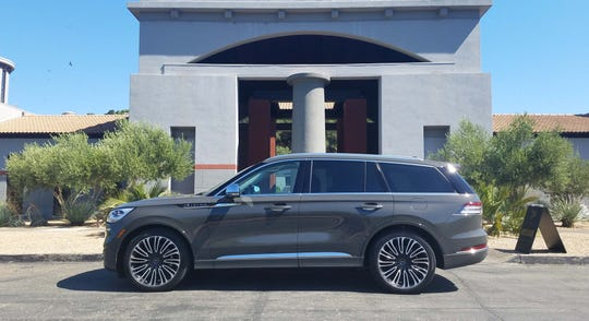 The 2020 Lincoln Aviator cuts a cool silhouette with its rear-wheel-driven proportions and Black Label tornado wheels.