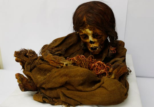 In this Aug. 15, 2019 photo, the 500-year-old mummy of an Incan girl sits inside a vault at the National Museum of Archaeology in La Paz, Bolivia.