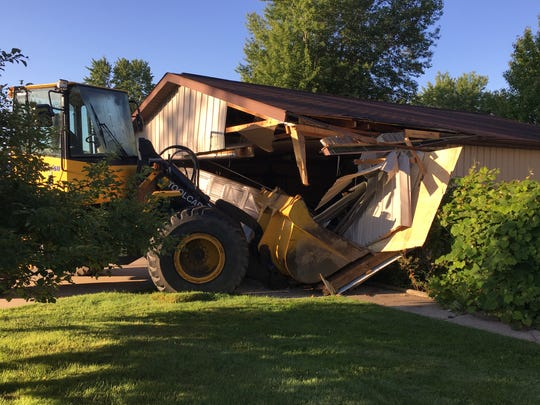 Michigan State Police in Houghton Lake said a front end loader stolen from a construction zone Tuesday was found crashed into a garage.