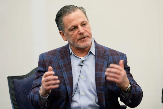 Detroit businessman Dan Gilbert has returned to Michigan after spending the past two months at a Chicago rehabilitation center following a stroke.