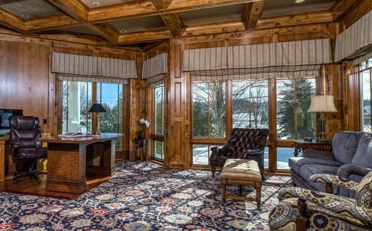 "This 10,000-square-foot estate, named ""Camelot,"" sits on Lake Michigan in Bay Harbor and lists for $7.9 million. It features seven bedrooms, a master suite on the main level with his and her bathrooms, custom closets and French doors that lead to a stone patio. There are also four more bedrooms suites on the second floor, each with views of the waterfronts. The third floor is designed with two additional bedrooms, a full bath and family room."
