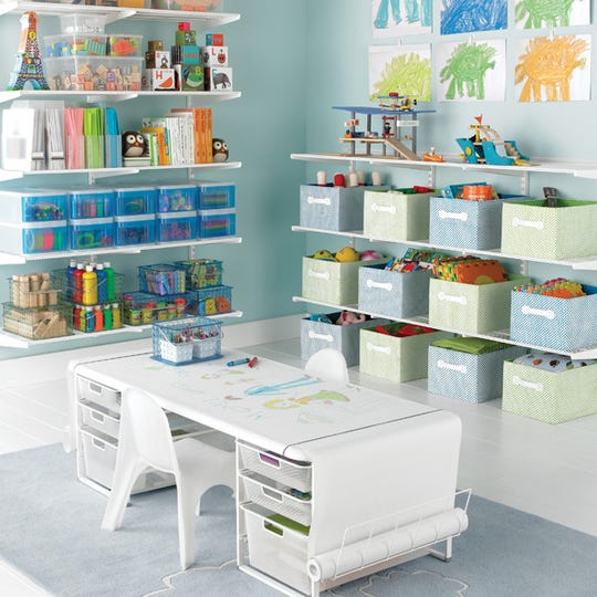 Turn a spare space into a playroom where kids' toys and school supplies can be neatly arranged in baskets, bins and drawers. A surface for activities keeps the floor neat and clean.