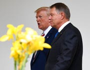 President Donald Trump, left, walks with Romanian President Klaus Iohannis, right, along the Colonnade of the White House in Washington, Tuesday, Aug. 20, 2019.