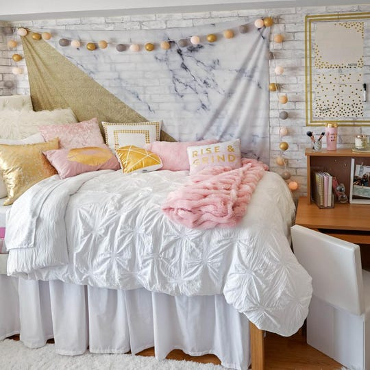 Dorm room decor affects students' happiness, a study says.