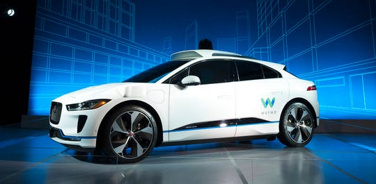 In this March 27, 2018 file photo, the Jaguar I-Pace vehicle outfitted with Waymo's suite of sensors and radar is introduced in New York. Google autonomous vehicle spinoff Waymo says it will start testing on public roads in Florida to better experience heavy rain.
