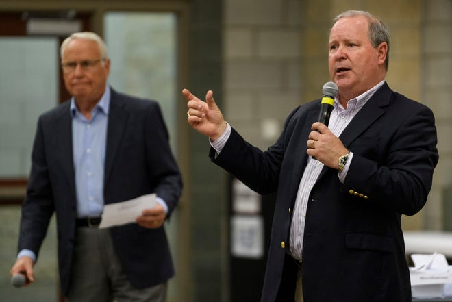 U.S. Rep. Larry Bucshon, right, answers a question as moderator David James of WNIN News, left, prepares to ask the next prepared question during a town hall meeting at the Southern Indiana Career & Technical Center in Evansville, Ind., Monday evening,  Aug. 19, 2019.