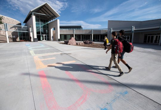 Kids walk to the entrance of Rocky Mountain High School in Fort Collins on the first day of school on Tuesday, Aug. 20, 2019.