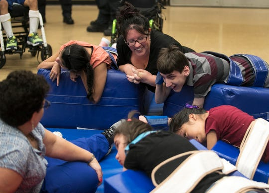 Buckingham Exceptional Student Center teacher Cheryl Zito jokes with her students while they use the school's new wedge mats on Tuesday, August 20, 2019.