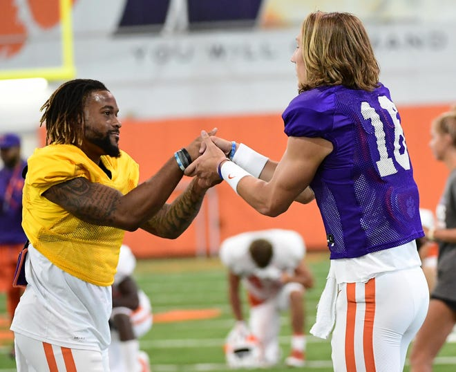 Clemson wide receiver Amari Rodgers (3) greets quarterback Trevor Lawrence (16) during practice at the Poe Indoor Facility at Clemson Tuesday, August 20, 2019.
