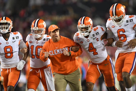 Clemson head coach Dabo Swinney with quarterback Deshaun Watson (4) and the rest of his team during pregame of the National Championship game at Raymond James Stadium in Tampa on Monday, January 9, 2017.