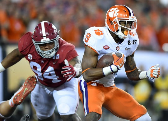 Clemson running back Wayne Gallman (9) carries against Alabama during the 1st quarter of the National Championship at Raymond James Stadium in Tampa on Monday, January 9, 2017.