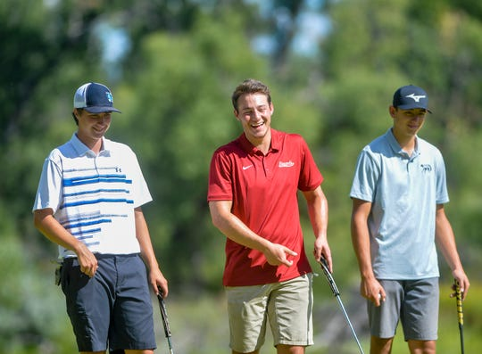Great Falls High's Trenton Olson, left, jokes with the other players in his group during the Great Falls Invitational Golf Tournament on Monday at Meadow Lark Country Club.