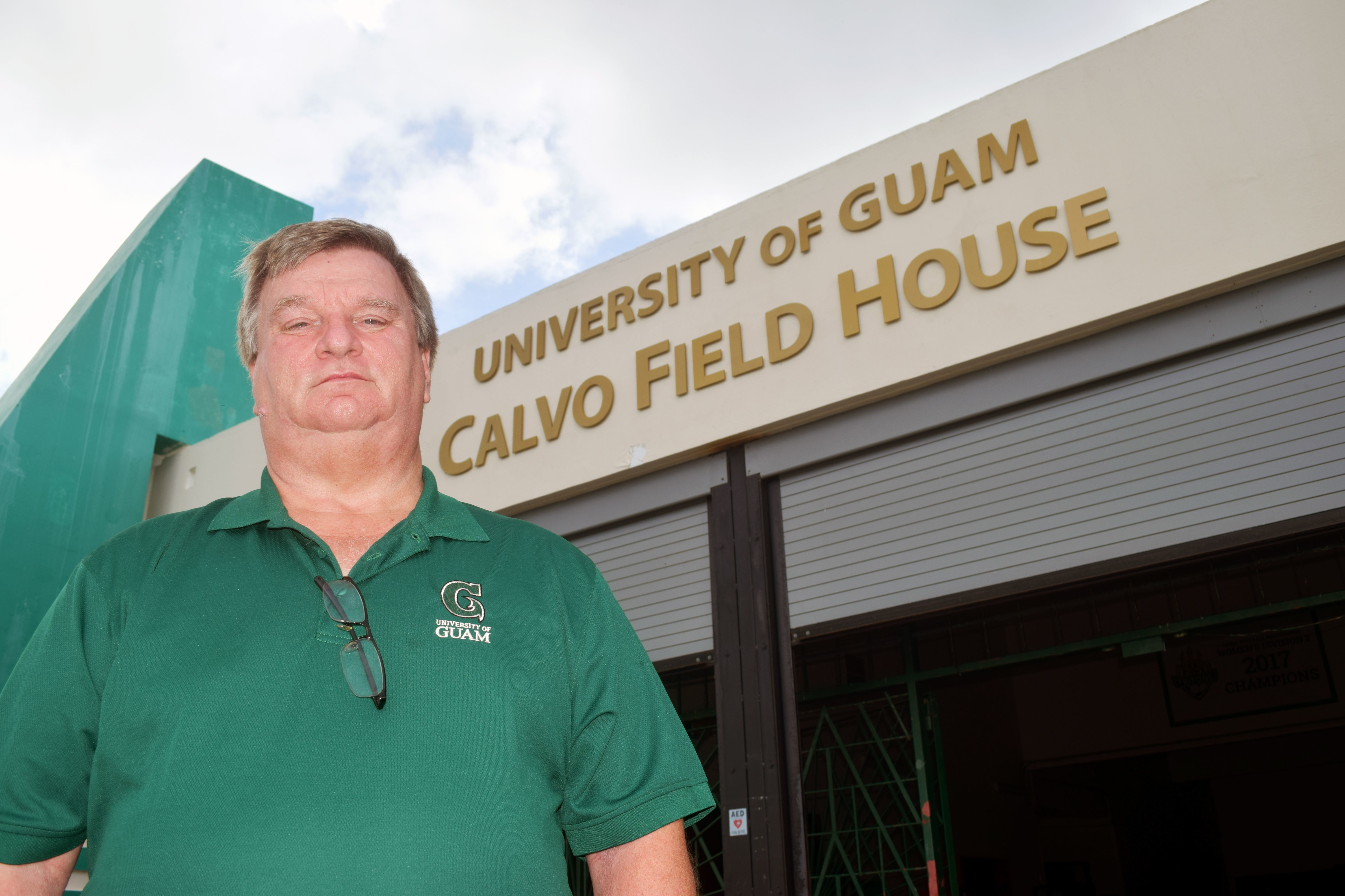 University of Guam Athletics Director Douglas Palmer stands outside the UOG Calvo Field House.