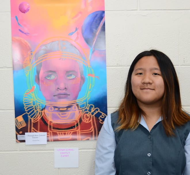 "Academy of Our Lady Sophomore student, Jasmine Sun, was selected to represent Guam at the Congressional Art Contest Reception held  June 24 at the U.S. Capitol Visitor Center in Washington, D.C..  Jasmine takes extracurricular art classes online and learned about the competition.  She created her piece entitled ""Through Blue Colored Glasses"" to help raise awareness for autism."