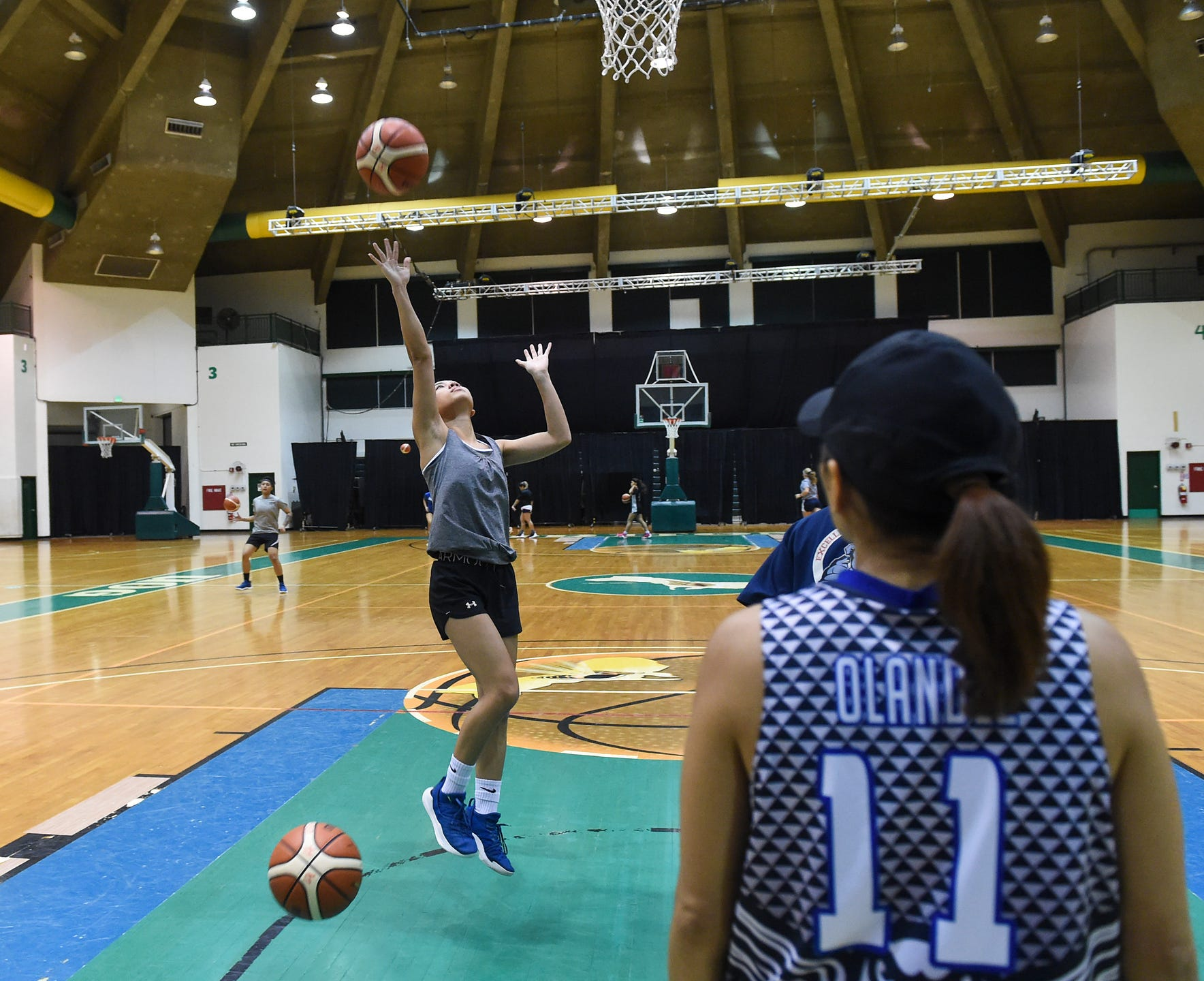 Basketball players try out for UOG's women's basketball team