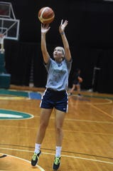 Paige Persha, a basketball player from Wisconsin, shoots a jumper during a University of Guam Tritons women's basketball team tryout at the UOG Calvo Field House in Mangilao, Aug. 20, 2019.