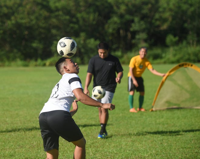 In this file photo from August 2019, players attend a tryout for the University of Guam Tritons men's soccer team at the UOG Field in Mangilao. The school recently announced tryouts for its spring semester 2020.