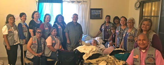 The Guam Sunshine Lions Club visited Agnes Mendiola, 71, of Dededo, on July 27 bringing cheer, songs, and supplies.  Pictured with members and Mendiola is Joe Mendiola.