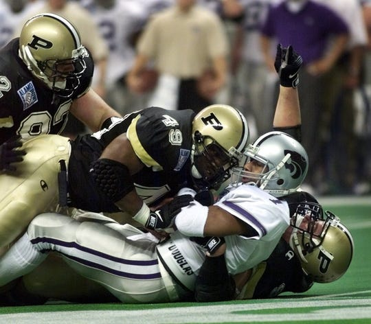 Chukie Nwokrie gets in on a tackle for Purdue against Kansas State in 1998.