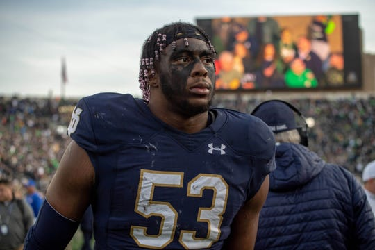 Fighting Irish defensive lineman Khalid Kareem (53) heads to the locker room after Notre Dame defeated the Pittsburgh Panthers at Notre Dame Stadium.