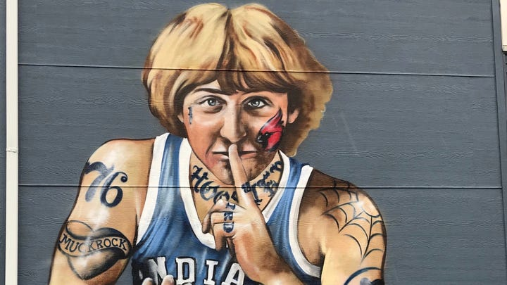 Artist will remove tattoos from Fountain Square mural of Larry Bird — except one