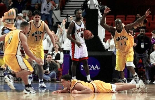 Valparaiso's Bryce Drew falls to the floor after making the most famous shot in Crusaders history in the 1998 NCAA tournament.