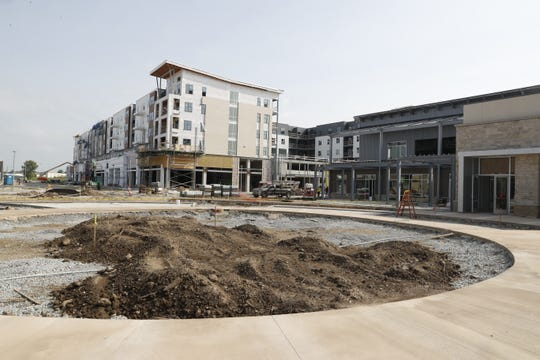 A 252-room apartment building is rising at the Fishers District, a restaurant complex at 116th Street and I-69.