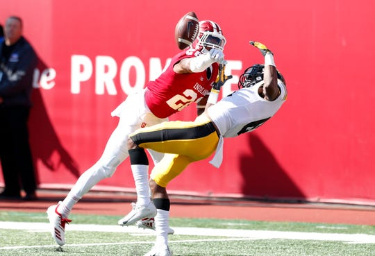 Indiana Hoosiers defensive back A'Shon Riggins (28) breaks up a pass intended for Iowa Hawkeyes wide receiver Ihmir Smith-Marsette (6) during the first quarter at Memorial Stadium .