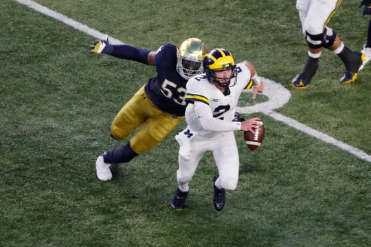 Michigan quarterback Shea Patterson (2) is sacked by Notre Dame Fighting Irish defensive lineman Khalid Kareem (53) during the first quarter at Notre Dame Stadium.