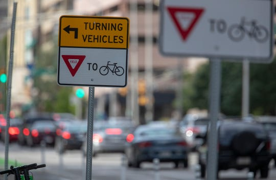 Signage along a newly built bicycle lane on Illinois Street in Downtown Indianapolis.
