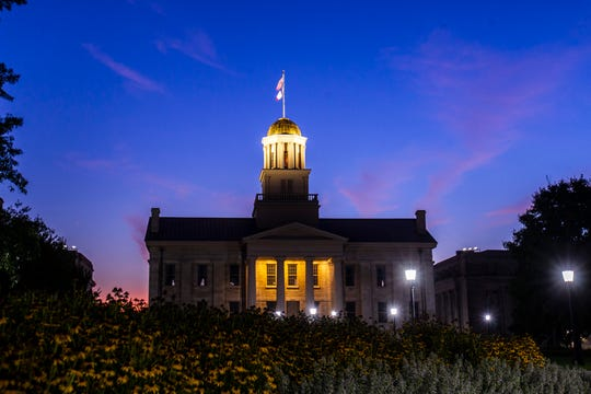 A blue and pink sky is illuminated as the sun sets behind the Old Capitol building, Monday, Aug. 19, 2019, on the University of Iowa campus in Iowa City, Iowa.
