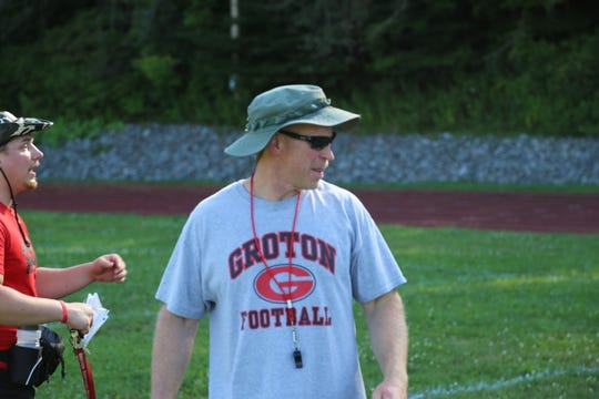 Pictured: (Center) Joe Manning, head coach of the Groton football team, and (left) Justin Albro, assistant coach, coach players during the first practice of the football season. Joe Manning is in his first year as the head coach of the football team.