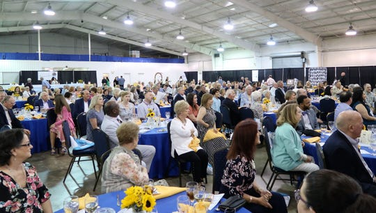The crowd listens to Bill Haltom speak at Sweet Tea & Seersucker event for Books of Madison County, the annual fundraiser for Jackson-Madison County Library.