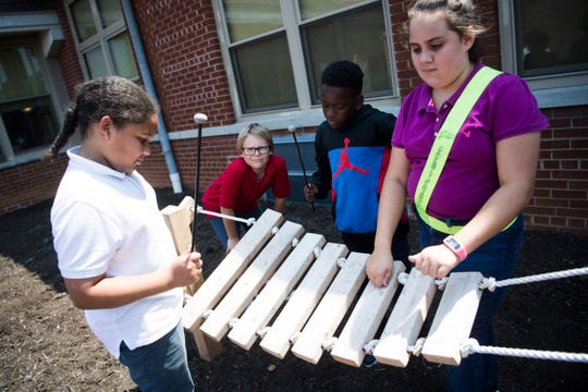 Students play with an instrument at Spring Hill Elementary's new sensory garden, which was funded by a Great Schools Partnership's TeacherPreneur grant of $20,000, Tuesday, Aug. 20, 2019.