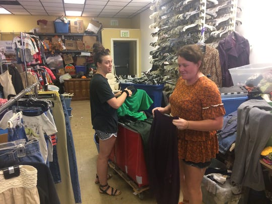 Kelsie Kennedy, front, and Jamie Blair get the donations ready to be put on the floor for sale.