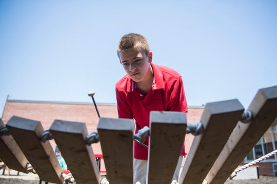 Caiden Gibson, 10, plays an instrument in Spring Hill Elementary's new sensory garden, which was funded by a Great Schools Partnership's TeacherPreneur grant of $20,000, Tuesday, Aug. 20, 2019.