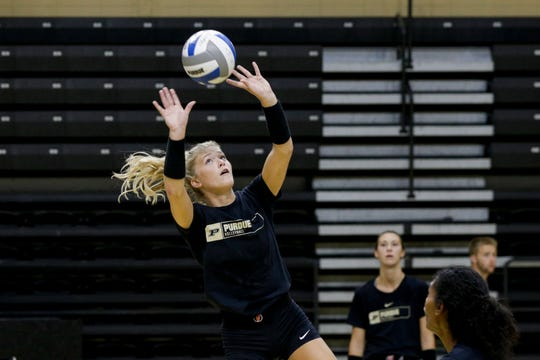 Purdue setter Hayley Bush (2) sets the ball during practice on Monday, Aug. 19, 2019 at Purdue's Holloway Gymnasium in West Lafayette.