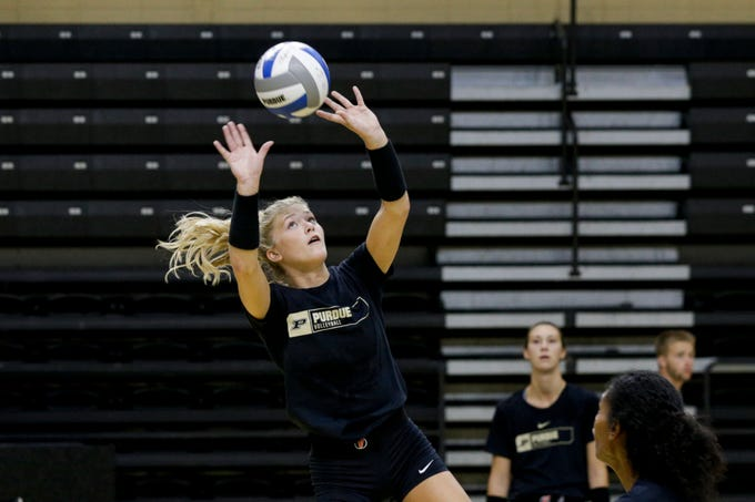 Purdue setter Hayley Bush (2) sets the ball during a practice, Monday, Aug. 19, 2019 at Purdue University's Holloway Gymnasium in West Lafayette.