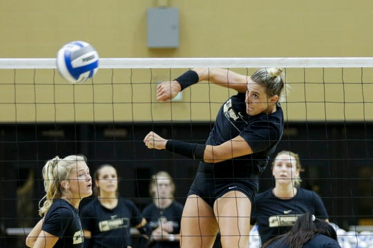 Purdue middle blocker Blake Mohler (17) spikes the ball during a practice, Monday, Aug. 19, 2019 at Purdue University's Holloway Gymnasium in West Lafayette.